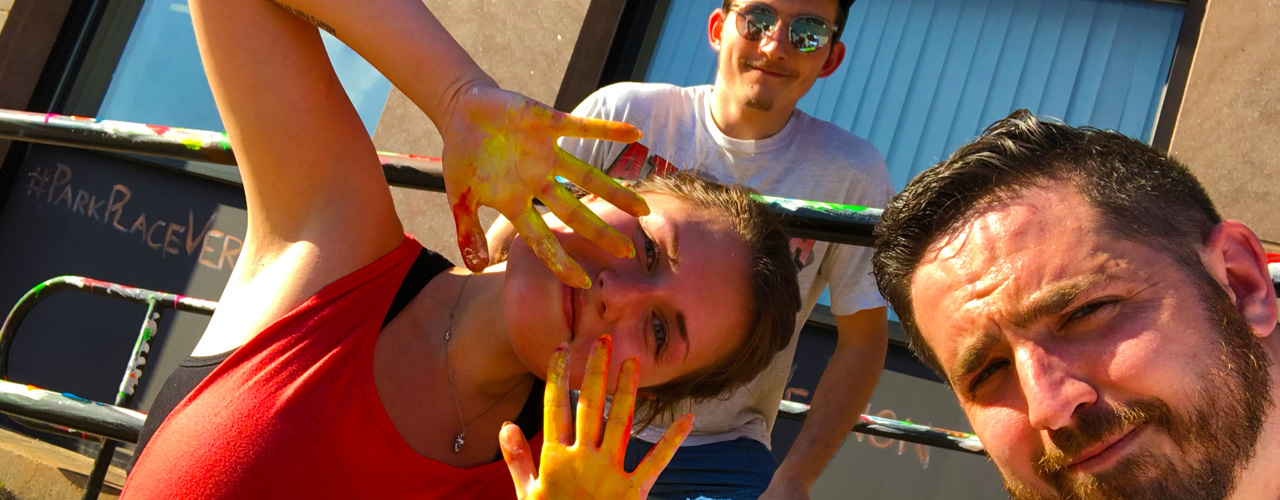 paint on smiling students hands